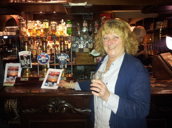 Paula Smart, one of the event organisers, enjoying a glass of Purity Saddleblack at the White Rose.