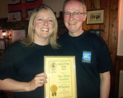 Jo and Richard Bennett receiving the Pub of the Year Award.