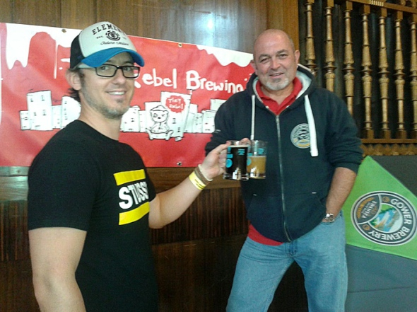 Gareth Williams from Tiny Rebel and Dave Campbell of Gower Brewery accept the award.