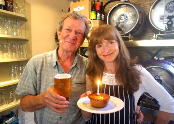 Rod Undy and Karen McGeoch celebrating the first birthday of Mumbles Ale House.