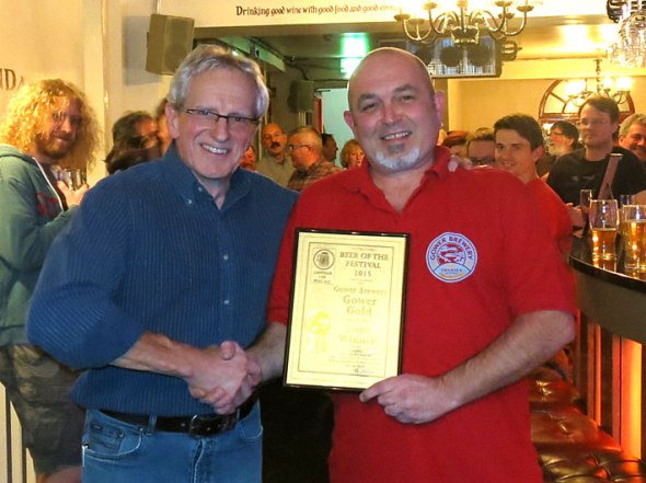 Dave Campbell of Gower Brewery being presented with the award by Chris Radford.