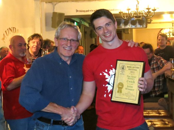 Mike Owen of Tiny Rebel receives the award from festival chairman Chris Radford.