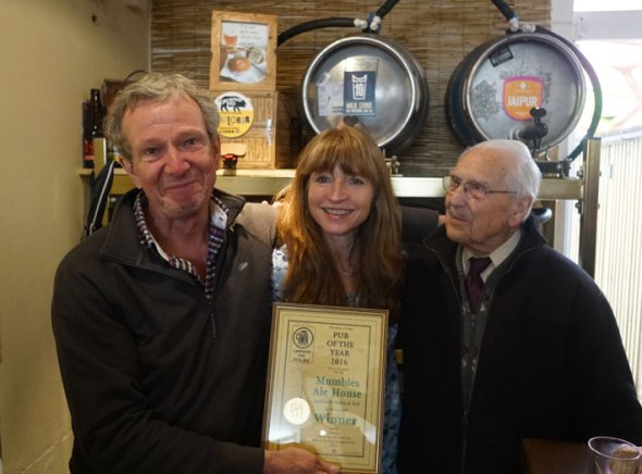 Rod Undy and Karen McGeoch receive the Pub of the Year Award along with Rod's dad John.