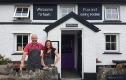 Licensee Paul Crowther with bartender Aprill Richards outside the historic Welcome to Town.