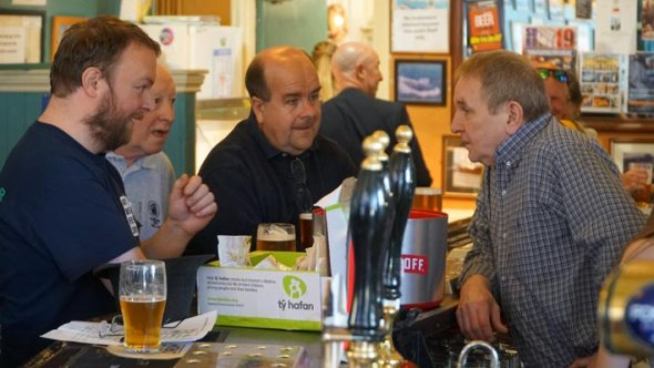 Camra members Donough Shanahan, Paul James and Stewart Pinching at the bar with landlord Gary Owen.
