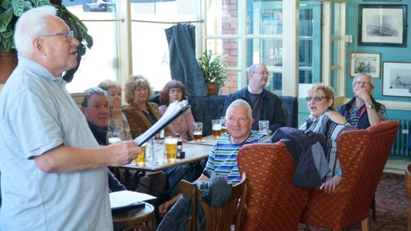 Swansea Camra members listen as branch chairman Paul James makes the award speech.