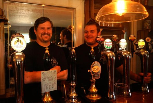 Brewer Gareth Moule, left, with some of Tomos Watkin's cask and keg ales and ciders.