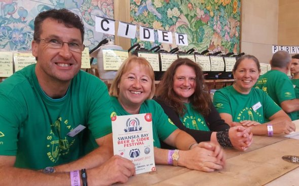 Volunteers serving on the cider stall at last year's beer and cider festival.