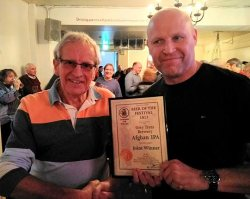 Chris Radford, beer festival chairman, presents the award to Ray Davies of Grey Trees Brewery.