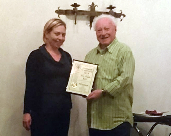 Becky Oliver of the No Sign receives her Cider Pub of the Year award award from Swansea Camra chairman Paul James.